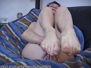 Oldie mistress in bikini displays her feet for a tease