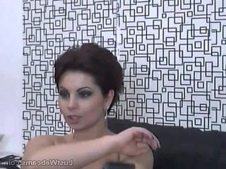 Busty milf toys herself on cam
